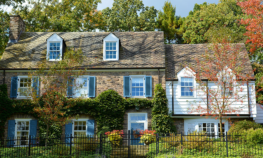 Colorworks exterior painting blue shutters on stone house